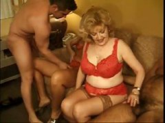 Two mature babes suck two dude's cock...