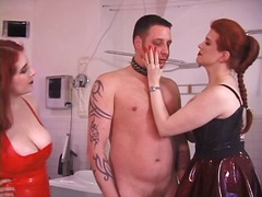 Two redhaired Dominatrix torment slav...
