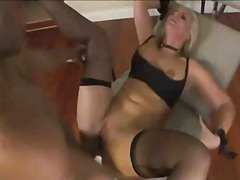 Busty blonde poses and shows off befo...