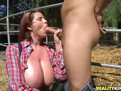 Busty and arousing redhead cowgirl lisa