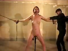 Girl on chains clips on her pussy vib...