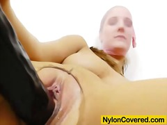 Brunette rides fake cock in tights