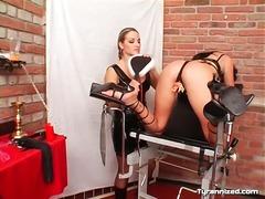 Clamps on the cunt of girl submitting...