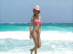 Karla carrillo in pink at the beach