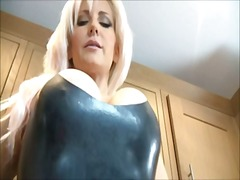 Blonde dominatrix in latex teases you
