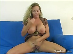 Amber uses a big dildo while rubber h...