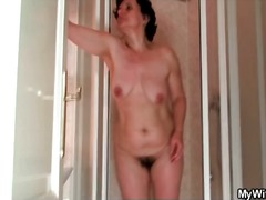 Alpha Porno - Mature showers her curvy body and hairy pussy