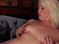 Milf gropes her titties and rubs her ...