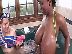Huge tits busty ebony in the jacuzzi